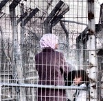 Palestinian woman and children at Taybe checkpoint
