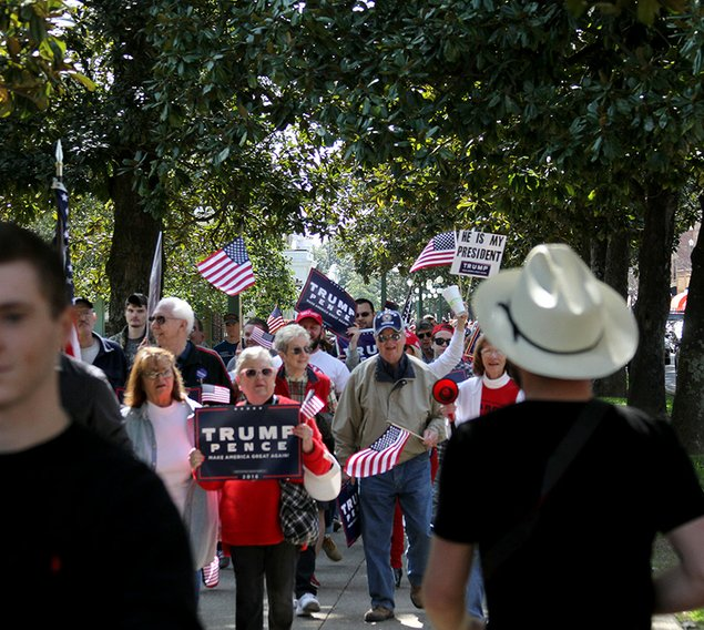 MARCHING: Supporters of President Trump head back to Arlington Lawn after marching to Hill Wheatley Plaza at around noon Saturday. The march followed the March 4 Trump rally Saturday.